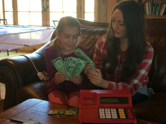 Clara learning to count money with tutor, Brittany Weisler