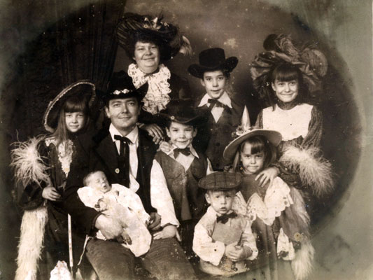 Top left to right: Mom, Douglas, Lydia. Middle row from left: Kimber, Dad, Paul, Robin. Front: Ethan (infant) and Travis